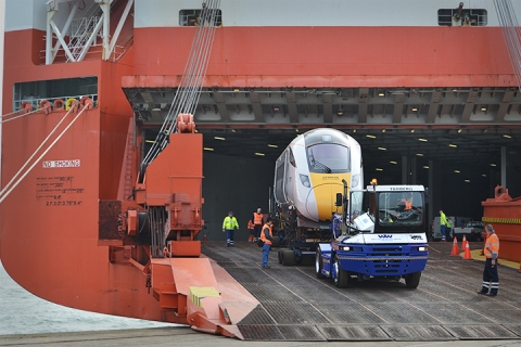 Hitachi Train Being Loaded Off A Ship Into The UK