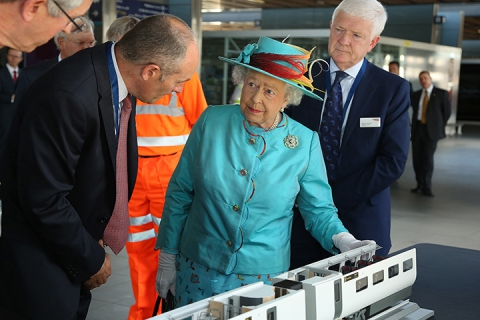 Queen reviews Hitachi train model