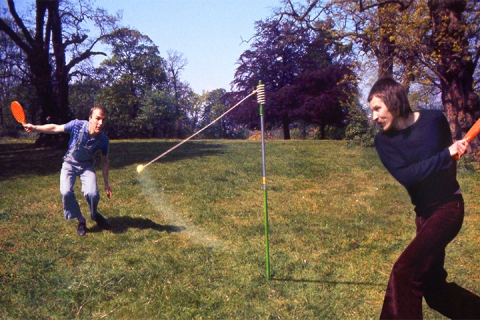 Swingball Being Used In a Garden
